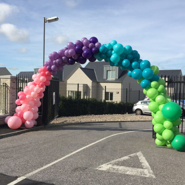 Bubble Gum Parade Giant Balloon Arch over gate Red Balloon Cork Balloons Delivered